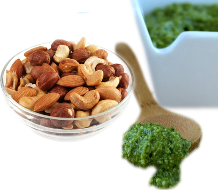 Mixed nuts and pesto_white background