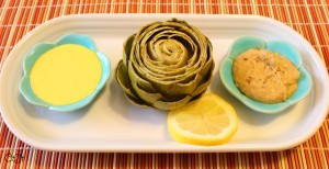 Steamed artichokes with hollandaise and Greek dip