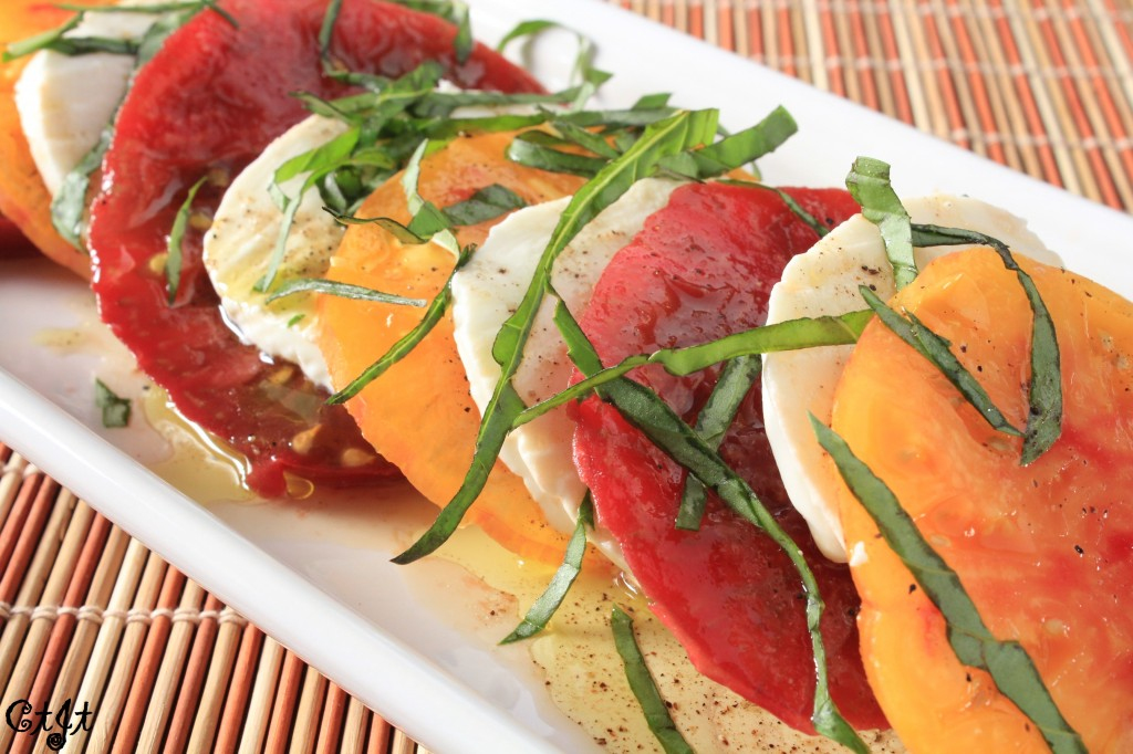 Caprese Salad with Heirloom Tomatoes Drizzled with a Summertime Peach White Balsamic & Meyer Lemon Olive Oil Vinaigrette featuring Sigona's Meyer Lemon Fusion Olive Oil and Sigona's Summertime Peach White Balsamic