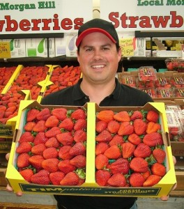 Robbie holding Chiala Farm Strawberries