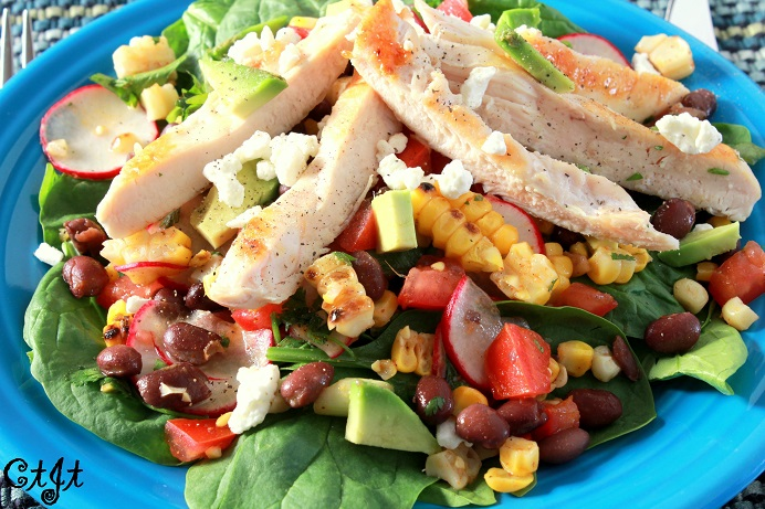 Grilled Corn, Chicken & Black Bean Salad on a Bed of Leafy Greens