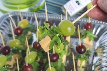 Grape, Arugula and Gouda Skewers with a Walnut-Thyme Drizzle featuring Sigona's Roasted French Walnut Oil