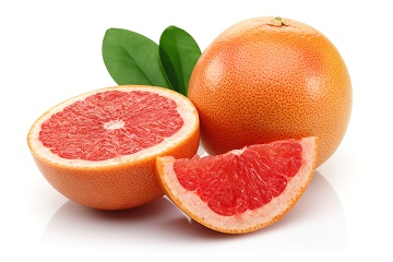 fresh grapefruit fruit with cut isolated on white background