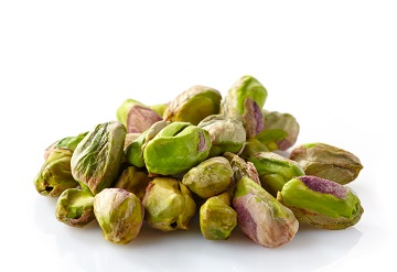 green pistachios on a white background