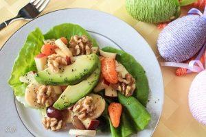 Fresh fruit salad with honey and poppyseed dressing on lettuce bed
