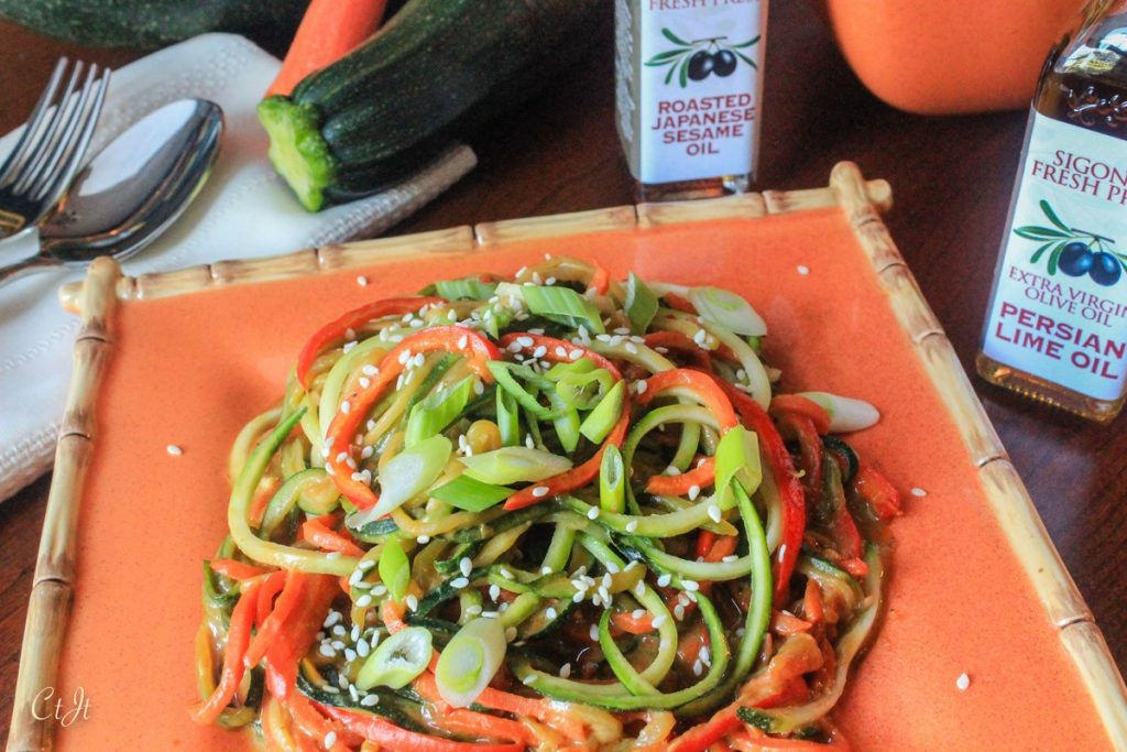 Thai Peanut Zoodles with Carrot and Bell Pepper featuring Sigona's Persian Lime Olive Oil, a gluten-free dish.