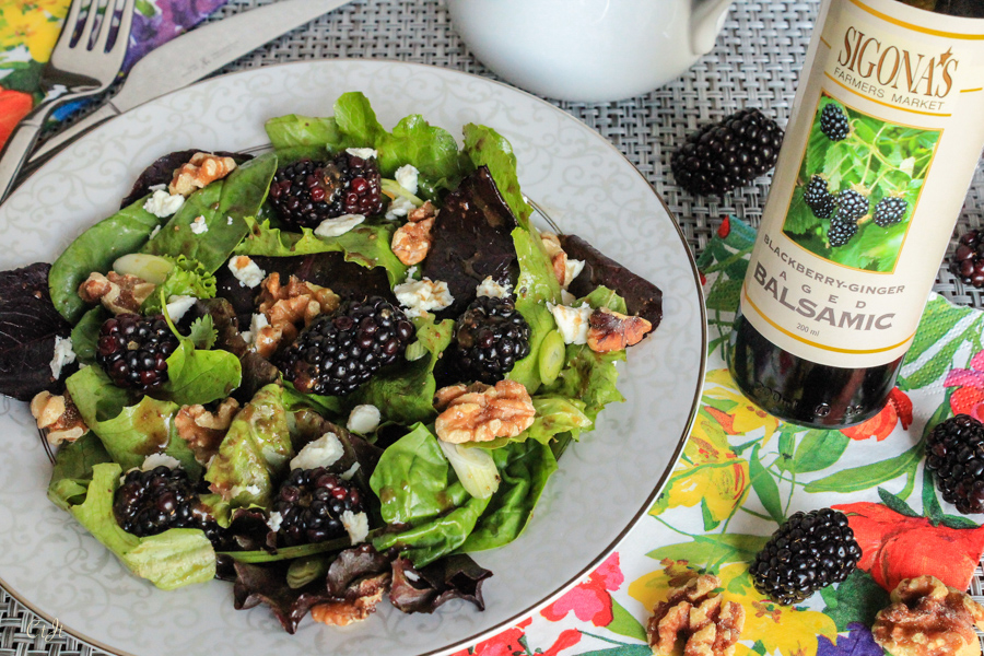 Mixed Greens with a Blackberry-Ginger Balsamic & Roasted French Walnut Oil Vinaigrette featuring Sigona's Blackberry Ginger Balsamic Vinegar and Sigona's Roasted French Walnut Oil