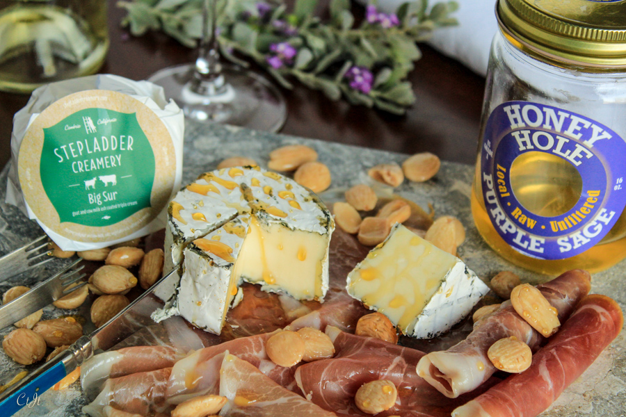 Big Sur On a Cheese Board with Herbes de Provence seasoned Marcona Almonds featuring Sigona's Herbes de Provence Olive Oil