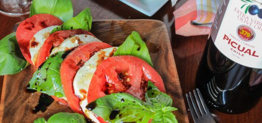 Traditional Caprese with heirloom tomatoes, olive oil and aged balsamic