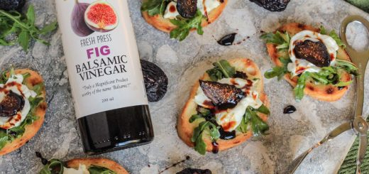 Chèvre & Arugula on Tuscan Herb Toasts with a Fig Balsamic Reduction
