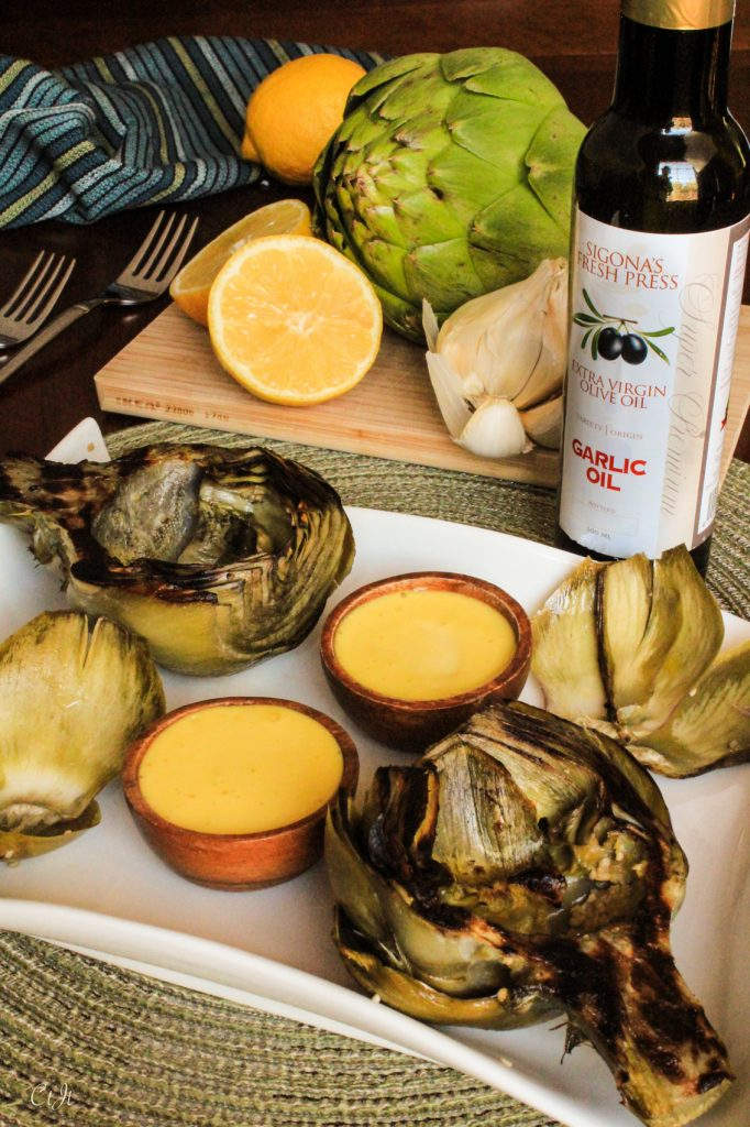 Grilled Artichokes with Garlic Aioli recipe featuring Sigona's Garlic Oil and Sigona's Meyer Lemon Fusion Olive Oil. Whole30. Paleo.