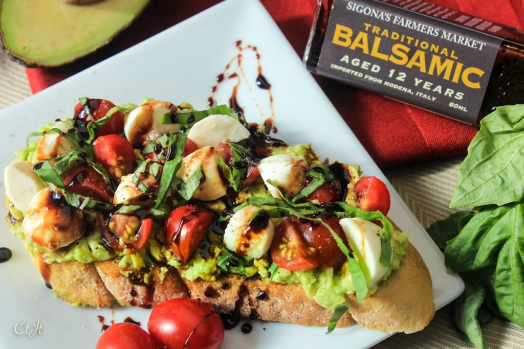 Avocado Toast a la Caprese with a Balsamic Reduction featuring Sigona's Traditional 12-year-aged Balsamic Vinegar and Sigona's Garlic Oil.