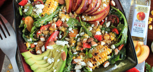 Fresh Peach Grilled Corn and Arugula Quinoa Bowl with a Peach and Baklouti Green Chili Vinaigrette featuring Sigona's Summertime Peach White Balsamic and Sigona's Spicy Baklouti Olive Oil a fantastic loaded salad buddah bowl