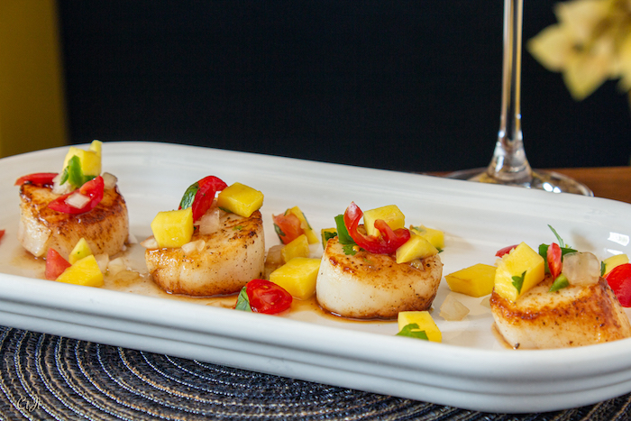 Harissa-Seared Scallops with a Mango Balsamic Salsa, a delicious sweet-heat weeknight dish.